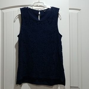 Blue sleeveless blouse.  Lace covered front.